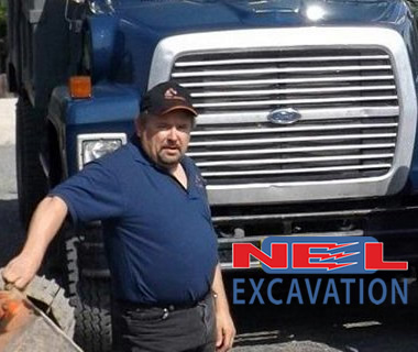 Terry Nowe in front of NEL Excavation truck